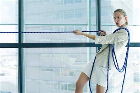 Businesswoman playing tug of war Stock Photo - Premium Royalty-Free, Code: 632-05604322
