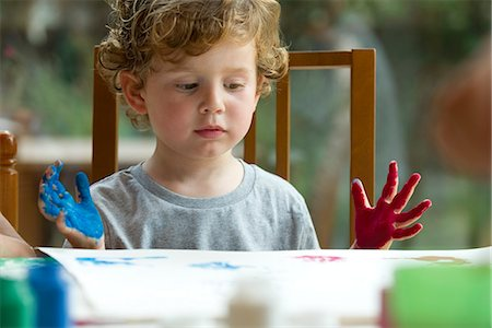 dirty - Little boy finger painting Stock Photo - Premium Royalty-Free, Code: 632-05604389
