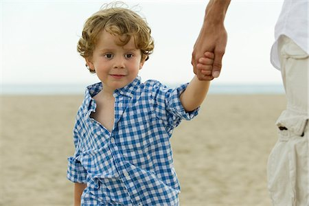 Little boy holding father's hand at the beach, cropped Stock Photo - Premium Royalty-Free, Code: 632-05604421