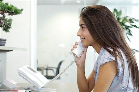 switchboard operator - Woman talking on landline telephone Stock Photo - Premium Royalty-Free, Code: 632-05604423