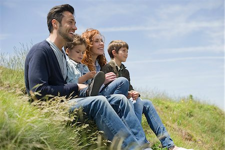 Parents with young boys sitting on meadow Stock Photo - Premium Royalty-Free, Code: 632-05604604