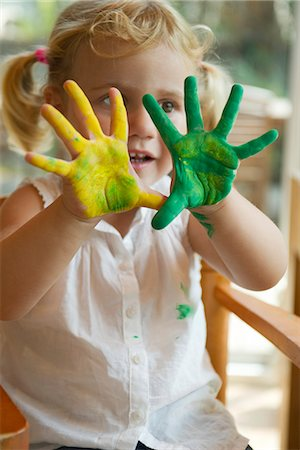 paint - Little girl with paint on her hands Stock Photo - Premium Royalty-Free, Code: 632-05603891