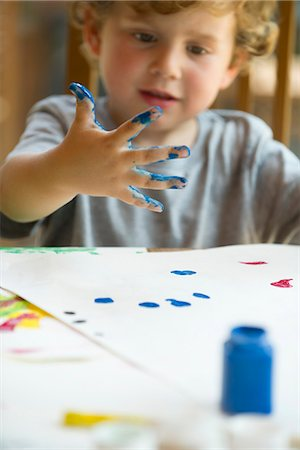 dirty - Little boy finger painting Stock Photo - Premium Royalty-Free, Code: 632-05603954