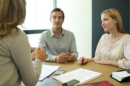 Couple talking with financial advisor Stock Photo - Premium Royalty-Free, Code: 632-05759477