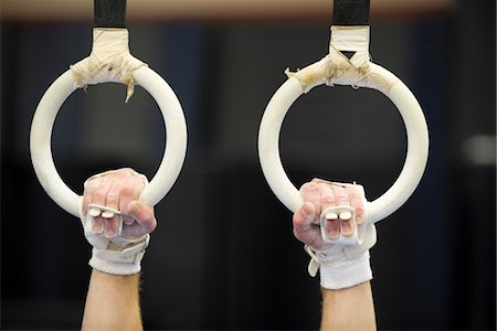 Gymnast's hands gripping the rings, cropped Stock Photo - Premium Royalty-Free, Code: 632-05759567