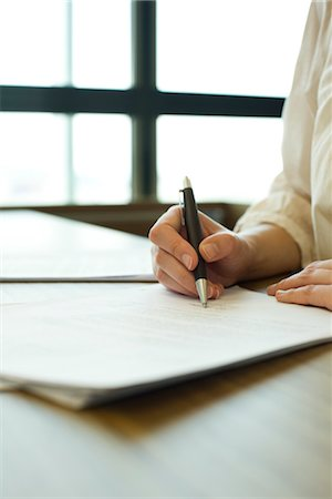 Person signing contract, cropped Stock Photo - Premium Royalty-Free, Code: 632-05759609