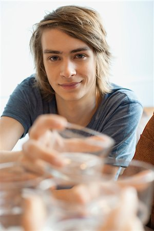 Young man raising glass Stock Photo - Premium Royalty-Free, Code: 632-05759611