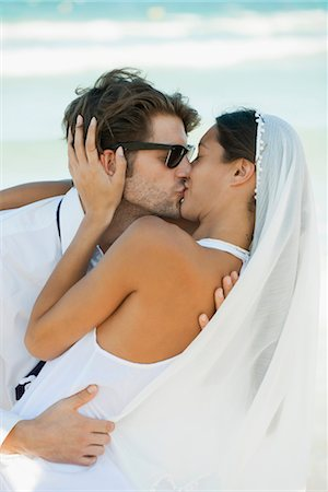 Bride and groom kissing at the beach Stock Photo - Premium Royalty-Free, Code: 632-05759637