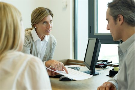 Businesswoman discussing contract with clients Stock Photo - Premium Royalty-Free, Code: 632-05759630