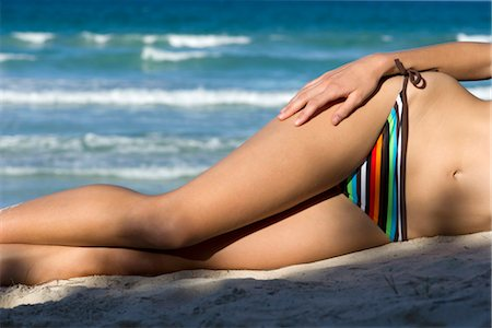 slim - Woman in bikini lying on beach, low section Stock Photo - Premium Royalty-Free, Code: 632-05759821