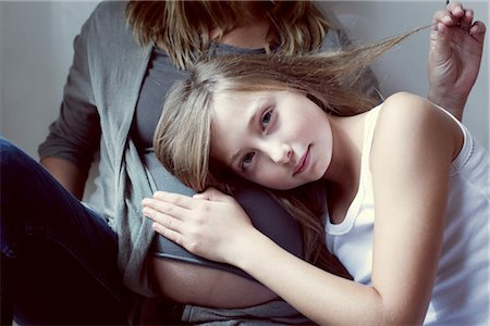preteen touch - Girl listening to mother's abdomen Stock Photo - Premium Royalty-Free, Code: 632-05759835