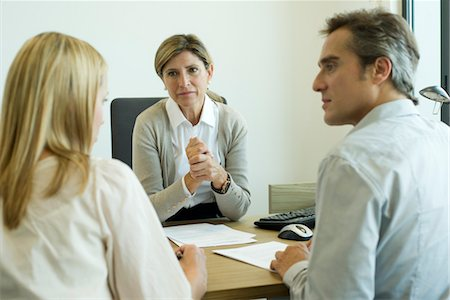 Businesswoman talking with clients in office Stock Photo - Premium Royalty-Free, Code: 632-05759878
