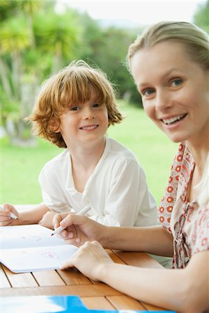 Mother and son coloring together Stock Photo - Premium Royalty-Free, Code: 632-05759980
