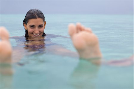 sole - Woman floating in water, portrait Stock Photo - Premium Royalty-Free, Code: 632-05760048