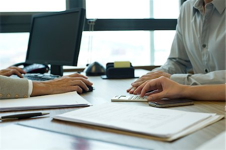 Business associates negotiating deal, cropped Stock Photo - Premium Royalty-Free, Code: 632-05760106