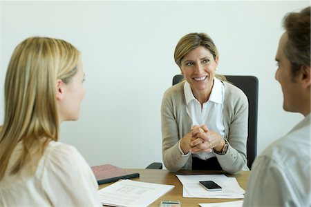 Businesswoman talking with clients in office Stock Photo - Premium Royalty-Free, Code: 632-05760204