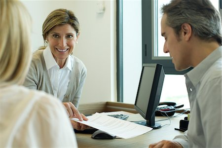 Businesswoman discussing contract with clients Stock Photo - Premium Royalty-Free, Code: 632-05760200