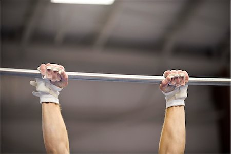 Gymnast gripping horizontal bar, cropped Stock Photo - Premium Royalty-Free, Code: 632-05760212