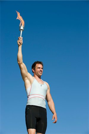 flame - Male athlete holding up torch Stock Photo - Premium Royalty-Free, Code: 632-05760224
