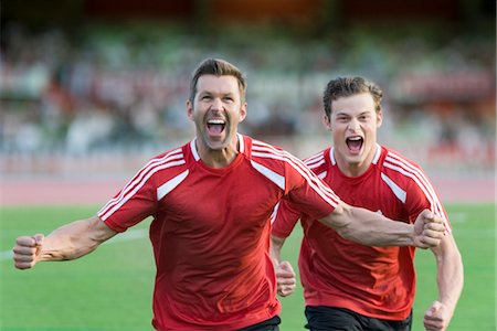 Soccer players shouting in victory Stock Photo - Premium Royalty-Free, Code: 632-05760227