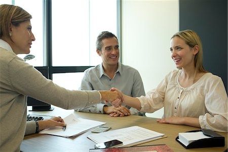 Businesswoman shaking hands with client in office Stock Photo - Premium Royalty-Free, Code: 632-05760258