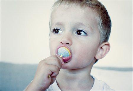 sucking - Toddler boy eating lollipop, portrait Stock Photo - Premium Royalty-Free, Code: 632-05760303