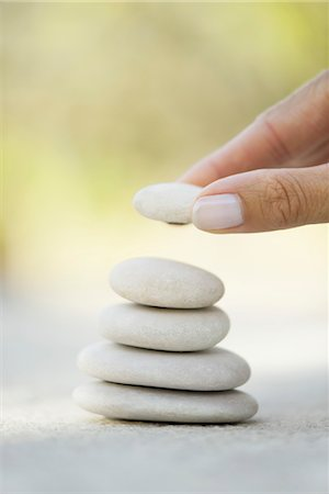 placing - Hand stacking pebbles Stock Photo - Premium Royalty-Free, Code: 632-05760310