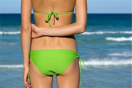 slim - Woman in bikini standing by sea Stock Photo - Premium Royalty-Free, Code: 632-05760324