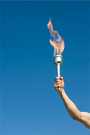 flame - Man's arm holding up torch Stock Photo - Premium Royalty-Free, Code: 632-05760375