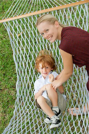 Mother tickling son in hammock Stock Photo - Premium Royalty-Free, Code: 632-05760370