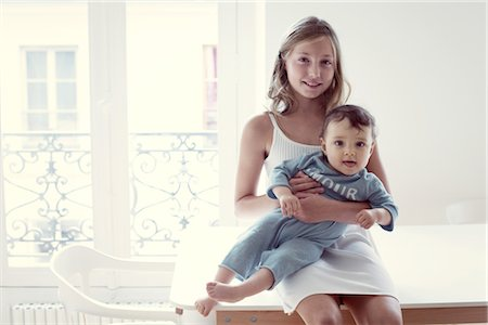 sister - Girl holding baby sister on lap, portrait Stock Photo - Premium Royalty-Free, Code: 632-05760388