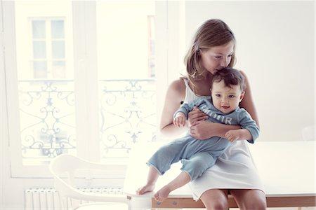 preteen kissing - Girl kissing baby sister on lap, portrait Stock Photo - Premium Royalty-Free, Code: 632-05760458