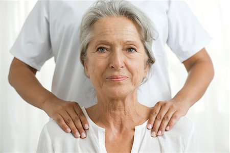 services - Senior woman getting a shoulder massage Stock Photo - Premium Royalty-Free, Code: 632-05760498