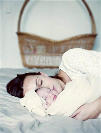 Mother and new born baby sleeping in bed Stock Photo - Premium Royalty-Free, Code: 632-05760583