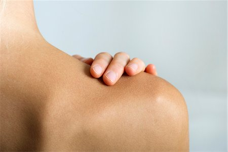 Woman with hand on bare shoulder, close-up Stock Photo - Premium Royalty-Free, Code: 632-05760604