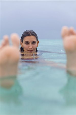 sole - Woman floating in water, portrait Stock Photo - Premium Royalty-Free, Code: 632-05760612
