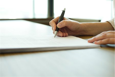 Person signing document, cropped Stock Photo - Premium Royalty-Free, Code: 632-05760699