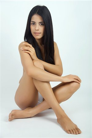 Woman sitting in underwear, full length portrait Stock Photo - Premium Royalty-Free, Code: 632-05816097