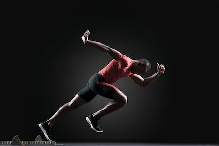 sprint - Male athlete leaving starting block Stock Photo - Premium Royalty-Free, Code: 632-05816144