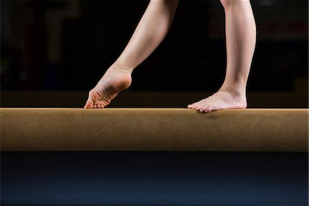 Female gymnast on balance beam, low section Stock Photo - Premium Royalty-Free, Code: 632-05816141