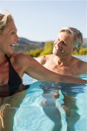 Mature couple relaxing together in pool Stock Photo - Premium Royalty-Free, Code: 632-05816188