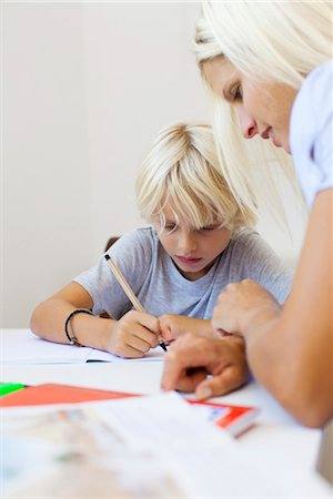 Mother helping son with homework Stock Photo - Premium Royalty-Free, Code: 632-05816250