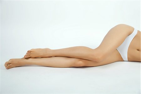 Woman lying down in underwear, low section Stock Photo - Premium Royalty-Free, Code: 632-05816279