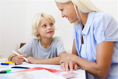 Mother helping son with homework Stock Photo - Premium Royalty-Free, Code: 632-05816281