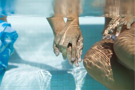 refraction - Couple holding hands underwater, cropped Stock Photo - Premium Royalty-Free, Code: 632-05816291