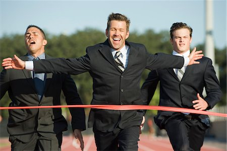 finish line - Businessman crossing finish line in race Stock Photo - Premium Royalty-Free, Code: 632-05816338