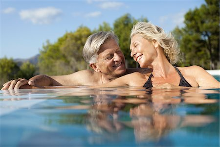 Mature couple relaxing together in pool Stock Photo - Premium Royalty-Free, Code: 632-05816341
