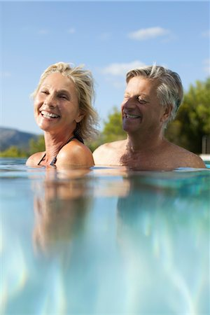 refraction - Mature couple relaxing together in pool Stock Photo - Premium Royalty-Free, Code: 632-05816342