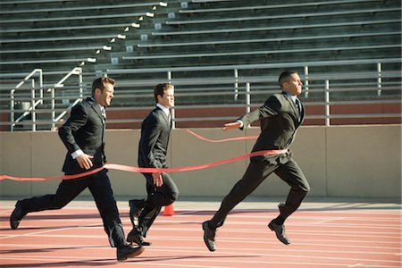 finish line - Businessman crossing finish line in race Stock Photo - Premium Royalty-Free, Code: 632-05816385