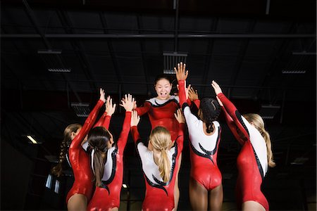 preteen girls gymnastics - Team of female gymnasts celebrating victory together Stock Photo - Premium Royalty-Free, Code: 632-05816391